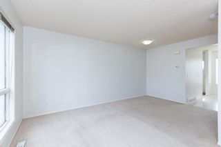 Photo 10: 887 Erin Woods Drive SE in Calgary: Erin Woods Detached for sale : MLS®# A1099055