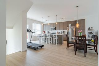 Photo 5: 145 Shawnee Common SW in Calgary: Shawnee Slopes Row/Townhouse for sale : MLS®# A1097036
