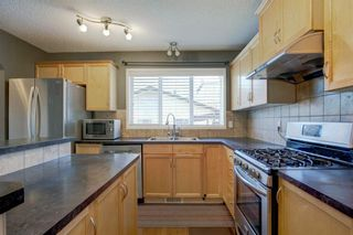 Photo 10: 313 Everglen Rise SW in Calgary: Evergreen Detached for sale : MLS®# A1115191