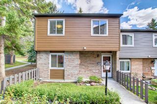 Photo 2: 104 210 86 Avenue SE in Calgary: Acadia Row/Townhouse for sale : MLS®# A1148130
