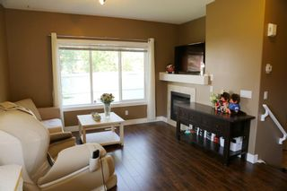 Photo 12: 84 BRIDLERIDGE Manor SW in Calgary: Bridlewood Row/Townhouse for sale : MLS®# A1029938