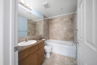 Photo 15: 3215 92 Crystal Shores Road: Okotoks Apartment for sale : MLS®# A1103721