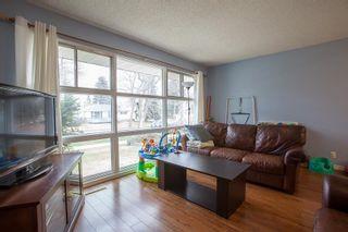 Photo 2: 8735 92B Avenue in Edmonton: Zone 18 House for sale : MLS®# E4249129