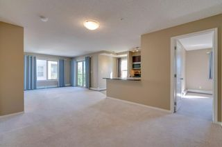 Photo 8: 9302 403 MACKENZIE Way SW: Airdrie Apartment for sale : MLS®# A1032027