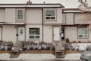 Photo 1: 203 DEERPOINT Lane SE in Calgary: Deer Ridge Row/Townhouse for sale : MLS®# C4288291