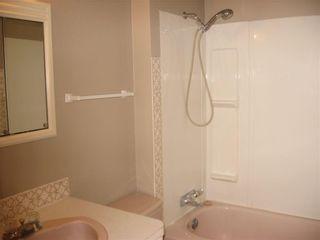 Photo 12: 220 50 Avenue: Claresholm Semi Detached for sale : MLS®# C4048339