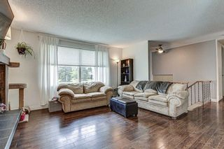 Photo 4: 128 Cedarpark Green SW in Calgary: Cedarbrae Detached for sale : MLS®# A1109711