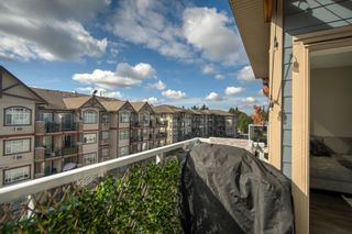 """Photo 25: 407 19936 56 Avenue in Langley: Langley City Condo for sale in """"Bearing Pointe"""" : MLS®# R2616051"""