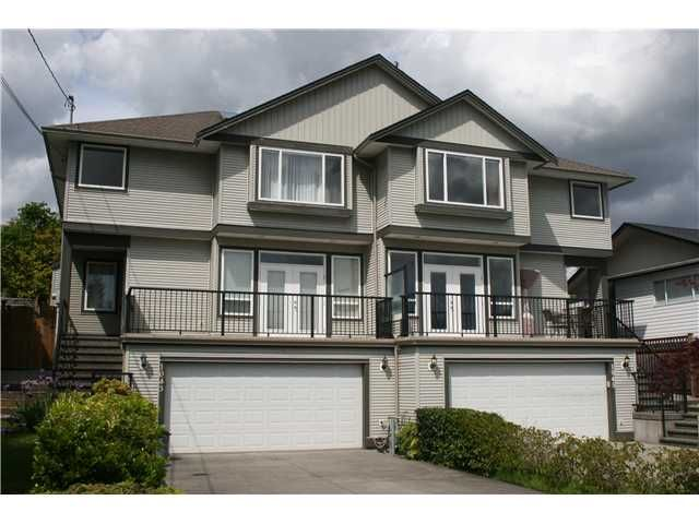 Main Photo: 1045 CHARLAND Avenue in Coquitlam: Central Coquitlam 1/2 Duplex for sale : MLS®# V1007417