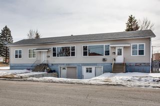 Main Photo: 4913 & 4915 16 Avenue SE in Calgary: Forest Lawn Row/Townhouse for sale : MLS®# A1082897