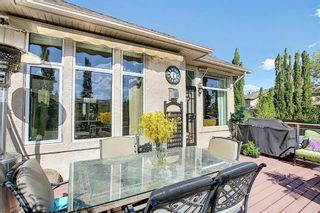 Photo 13: 31 Strathlea Common SW in Calgary: Strathcona Park Detached for sale : MLS®# A1147556