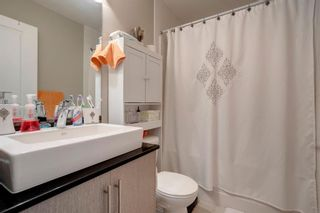 Photo 24: 15 West Coach Manor SW in Calgary: West Springs Row/Townhouse for sale : MLS®# A1100327