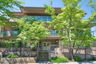 "Photo 1: 202 14980 101A Avenue in Surrey: Guildford Condo for sale in ""Cartier Place"" (North Surrey)  : MLS®# R2586660"