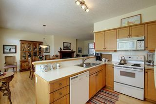 Photo 13: 45 Discovery Heights SW in Calgary: Discovery Ridge Row/Townhouse for sale : MLS®# A1109314