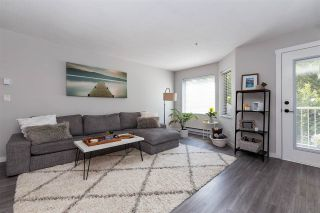 """Photo 1: 211 19236 FORD Road in Pitt Meadows: Central Meadows Condo for sale in """"Emerald Park"""" : MLS®# R2515270"""