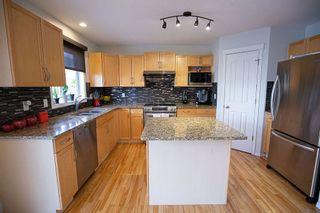 Photo 2: 6985 STROM Lane in Edmonton: Zone 14 House for sale : MLS®# E4237022