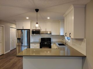 Photo 3: 72 EDENDALE Way NW in Calgary: Edgemont Detached for sale : MLS®# A1080431