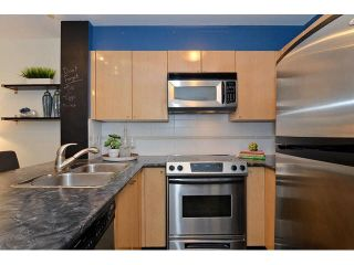 "Photo 7: 108 3278 HEATHER Street in Vancouver: Cambie Condo for sale in ""THE HEATHERSTONE"" (Vancouver West)  : MLS®# V1116295"