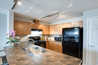 Photo 5: 3310 92 Crystal Shores Road: Okotoks Apartment for sale : MLS®# A1066113
