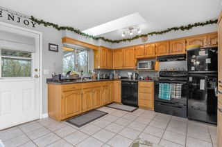 """Photo 4: 12392 230 Street in Maple Ridge: East Central House for sale in """"East Central Maple Ridge"""" : MLS®# R2542494"""