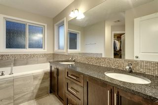 Photo 14: 144 Cougar Ridge Manor SW in Calgary: Cougar Ridge Detached for sale : MLS®# A1098625