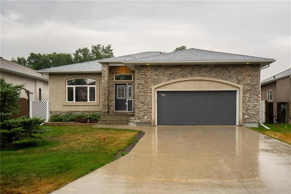 Stone facing exterior with oversized 24x22 insulated garage with tons of extra storage