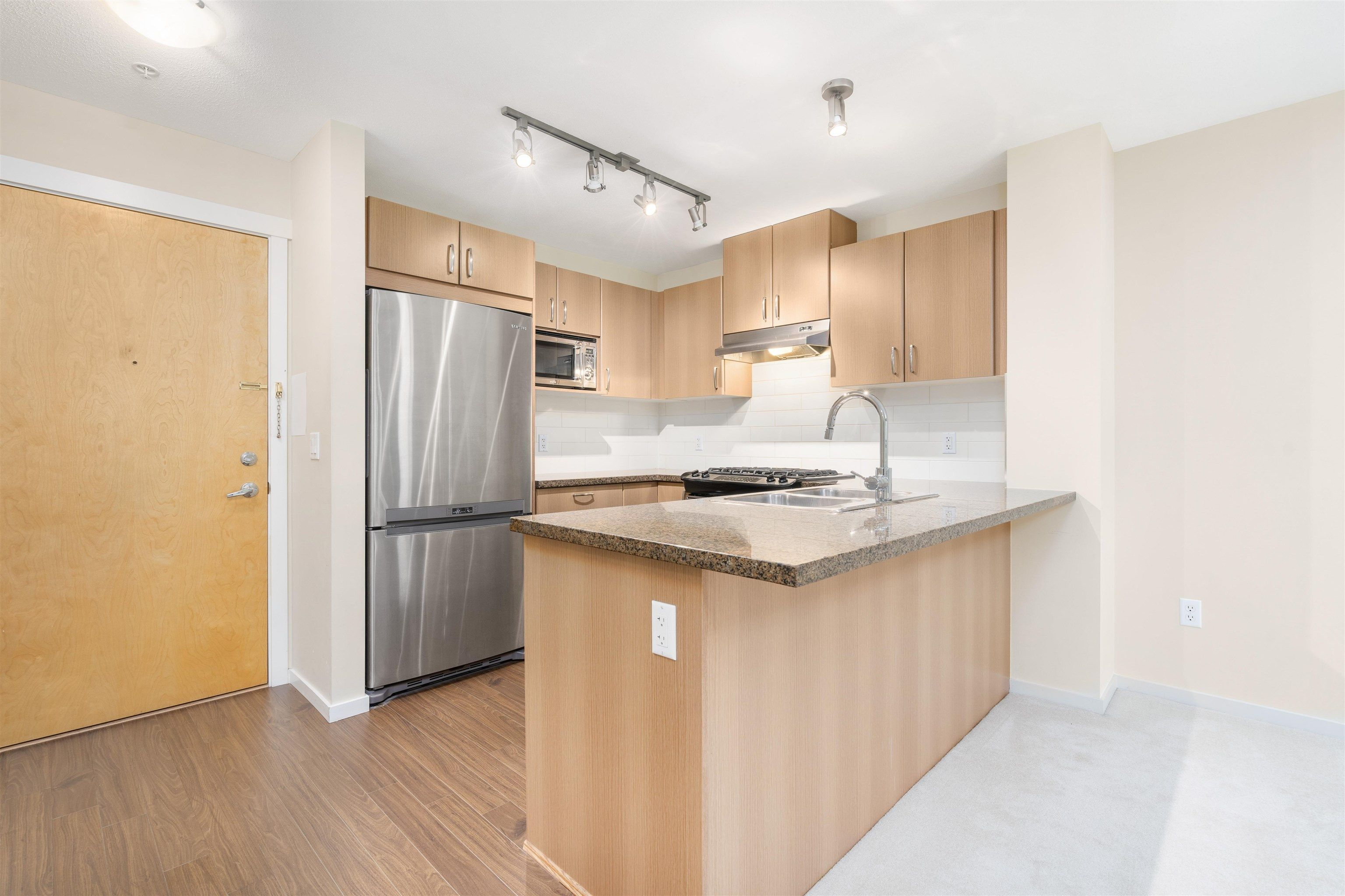 Main Photo: 310 3050 DAYANEE SPRINGS Boulevard in Coquitlam: Westwood Plateau Condo for sale : MLS®# R2624730