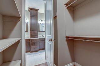 Photo 16: 72 Elysian Crescent SW in Calgary: Springbank Hill Semi Detached for sale : MLS®# A1148526
