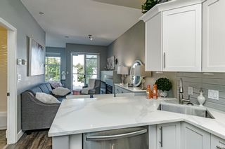 """Photo 19: #407 20200 56 Avenue in Langley: Langley City Condo for sale in """"The Bentley"""" : MLS®# R2598723"""