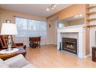 "Photo 4: 106 13860 70 Avenue in Surrey: East Newton Condo for sale in ""Chelsea Gardens"" : MLS®# R2243346"