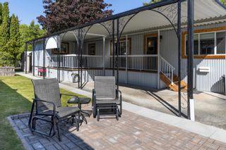 "Photo 1: 71 7850 KING GEORGE Boulevard in Surrey: East Newton Manufactured Home for sale in ""Bear Creek Glen"" : MLS®# R2623355"