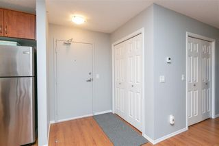 Photo 3: 2427 700 WILLOWBROOK Road NW: Airdrie Apartment for sale : MLS®# A1064770