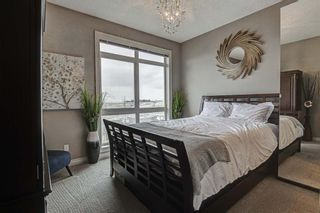 Photo 9: 7 124 Rockyledge View NW in Calgary: Rocky Ridge Row/Townhouse for sale : MLS®# A1111501