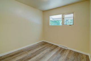 Photo 15: 50 FRASER Road SE in Calgary: Fairview Detached for sale : MLS®# A1145619