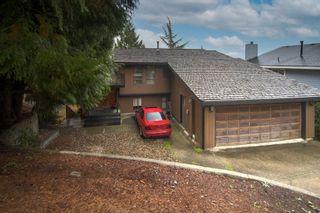 "Photo 2: 1305 CHARTER HILL Drive in Coquitlam: Upper Eagle Ridge House for sale in ""UPPER EAGLE RIDGE"" : MLS®# R2616938"