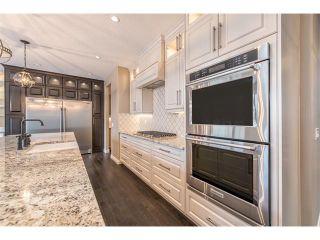 Photo 4: 22 ROCK LAKE View NW in Calgary: Rocky Ridge House for sale : MLS®# C4090662