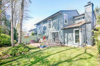 """Photo 1: 7260 WEAVER Court in Vancouver: Champlain Heights Townhouse for sale in """"Parklane"""" (Vancouver East)  : MLS®# R2354064"""