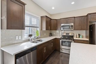 Photo 4:  in Calgary: Winston Heights/Mountview Row/Townhouse for sale : MLS®# A1105103