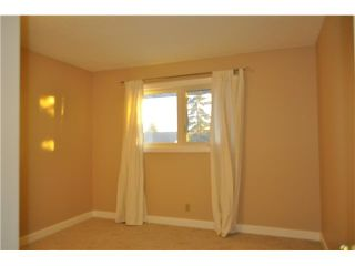 Photo 6: 557 SUMMERWOOD Place SE: Airdrie Residential Attached for sale : MLS®# C3592604