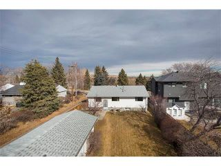 Photo 2: 3039 CANMORE Road NW in Calgary: Banff Trail House for sale