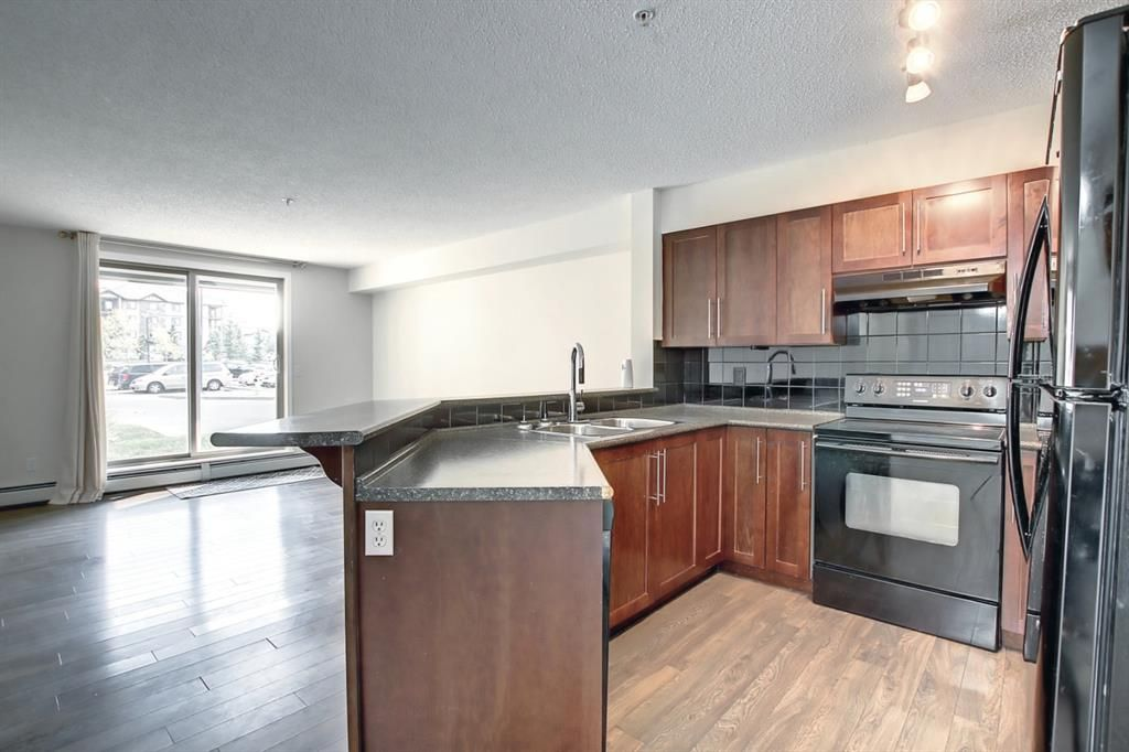 Main Photo: 3111 60 Panatella Street NW in Calgary: Panorama Hills Apartment for sale : MLS®# A1145815