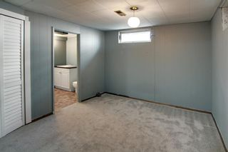 Photo 17: 22 Rossburn Crescent SW in Calgary: Rosscarrock Detached for sale : MLS®# A1083090