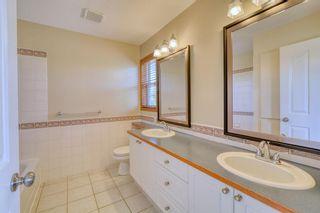 Photo 31: 12 West Hall Place: Cochrane Detached for sale : MLS®# A1119224