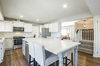 Photo 9: 884 Coach Side Crescent SW in Calgary: Coach Hill Detached for sale : MLS®# A1105957