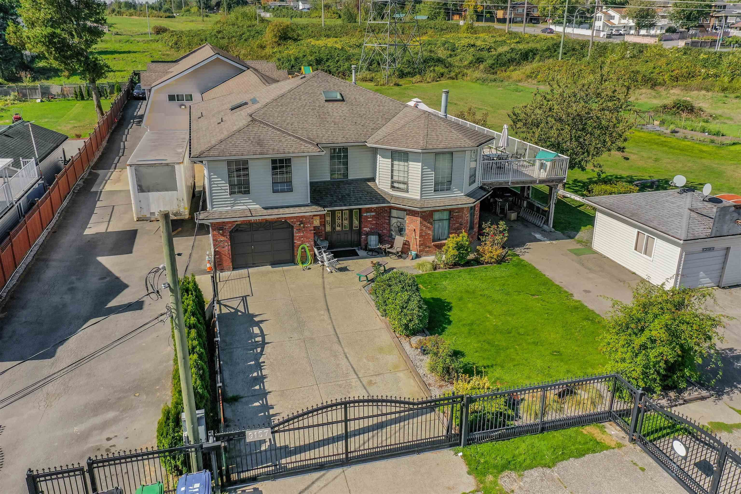 Main Photo: 9157 134B Street in Surrey: Queen Mary Park Surrey House for sale : MLS®# R2623226
