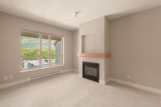 """Photo 3: 603 1211 VILLAGE GREEN Way in Squamish: Downtown SQ Condo for sale in """"ROCKCLIFF"""" : MLS®# R2573545"""