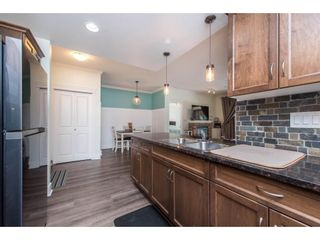 """Photo 11: 106 2068 SANDALWOOD Crescent in Abbotsford: Central Abbotsford Condo for sale in """"The Sterling"""" : MLS®# R2590932"""