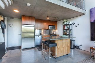 """Photo 4: 512 1540 W 2ND Avenue in Vancouver: False Creek Condo for sale in """"WATERFALL BUILDING BY ARTHER ERI"""" (Vancouver West)  : MLS®# R2186544"""