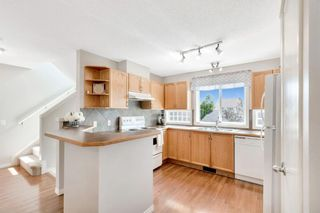 Photo 4: 317 TUSCANY SPRINGS Way NW in Calgary: Tuscany Detached for sale : MLS®# A1016440