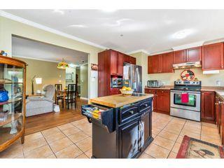 "Photo 8: 110 9650 148 Street in Surrey: Guildford Condo for sale in ""Hartford Woods"" (North Surrey)  : MLS®# R2447474"